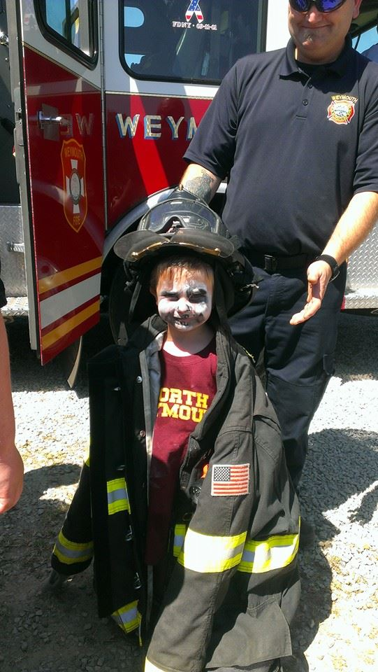 kid in fire gear